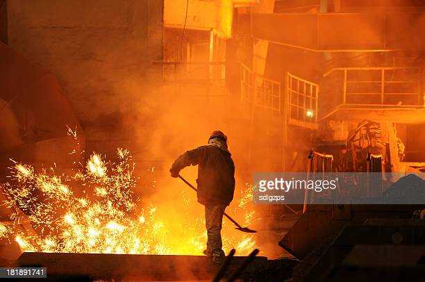 man is working in the splashing molten iron - steelmaking stock photos and pictures