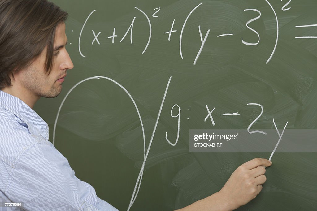 Man is writing prims on a board : Photo