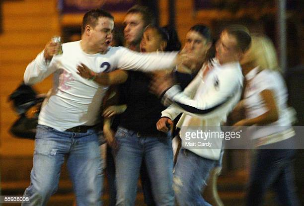 A man jabs out a companion during a arguement in Bristol City Centre on October 15 2005 in Bristol England Pubs and clubs preparing for the new...