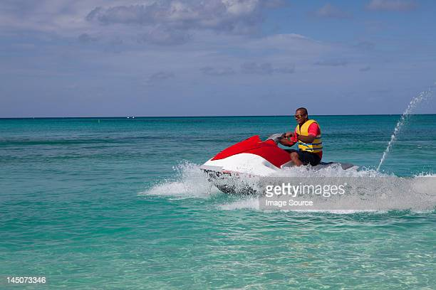 Man jet skiing in Caribbean sea, Grand Cayman, Cayman Islands