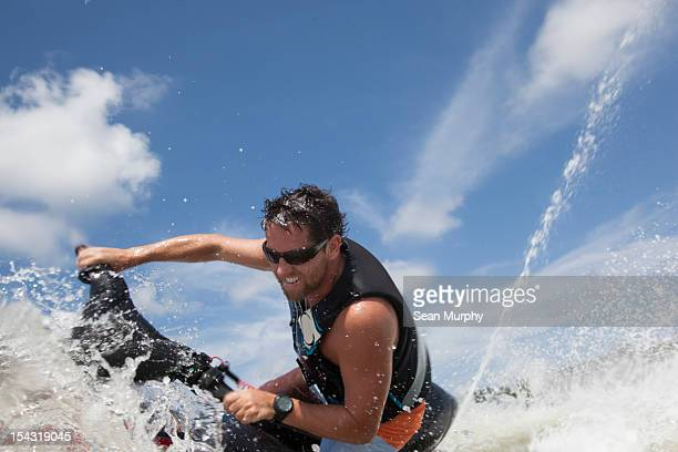 Man jet skiing in the ocean