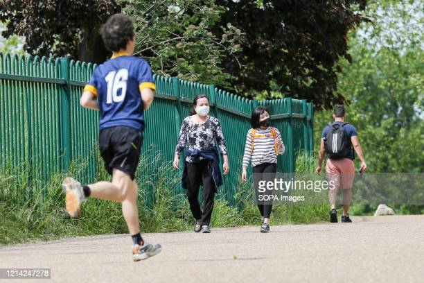Man jogging along Finsbury Park on a warm and sunny day during the covid 19 crisis. The UK government relaxed the guidelines on coronavirus lockdown,...
