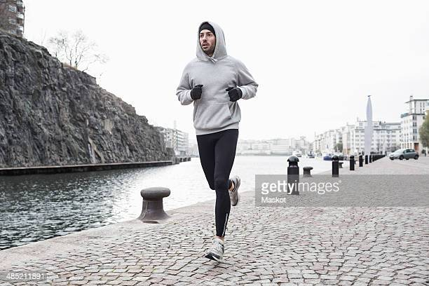 Man jogging at canal side