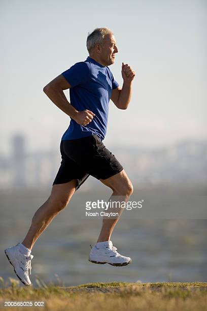 Man jogging, focus on foreground