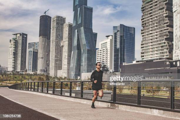 man jogging in the city - mexico city stock pictures, royalty-free photos & images