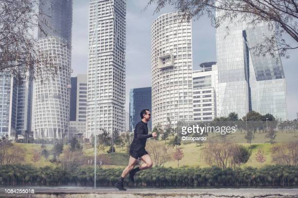 man jogging in the city - center athlete stock pictures, royalty-free photos & images