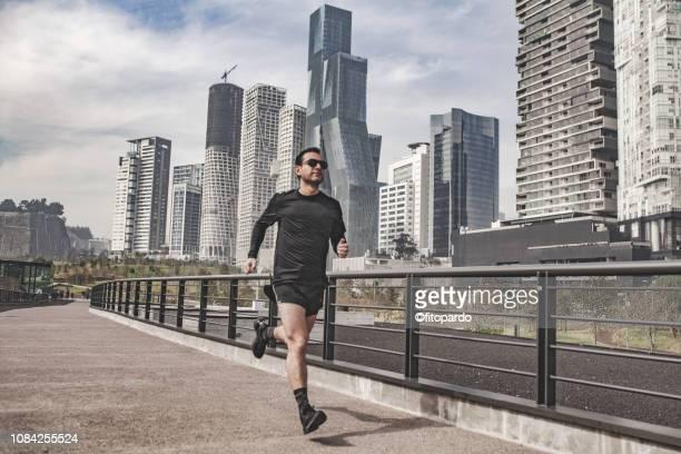 man jogging in the city - メキシコ 街 ストックフォトと画像