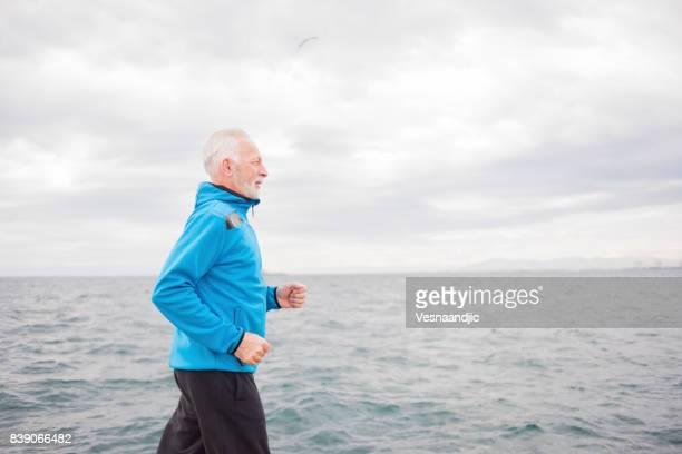Man jogging near sea