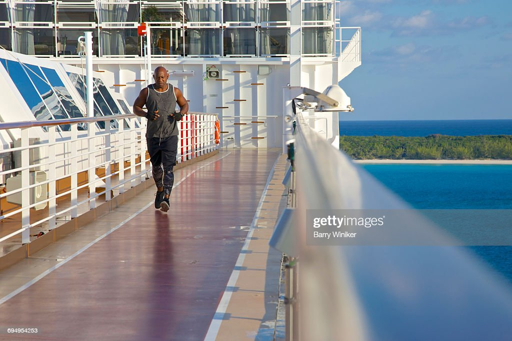 Man Jogging On Cruise Ship Track In The Bahamas Stock Photo - Cruise ship locater