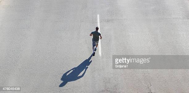 Mann Joggen auf der Straße, Textfreiraum