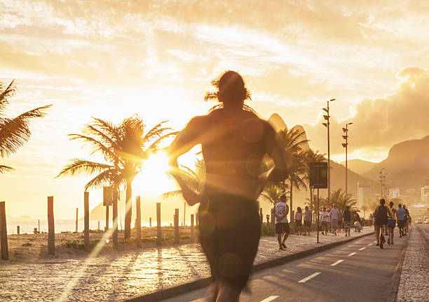 Man Jogging On The Beach Of Ipanema At Sunset Wall Art