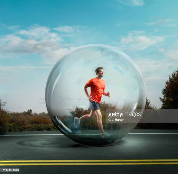 Man jogging surrounded by bubble