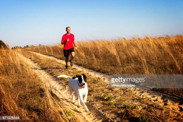 Man jogging with dog.