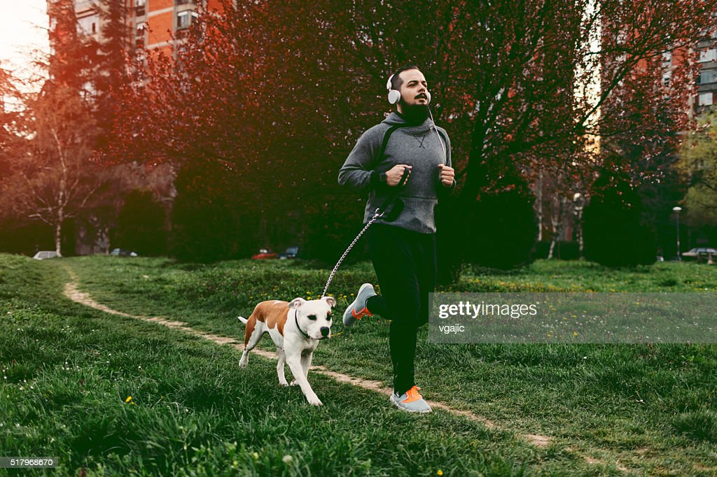 Man Jogging With His Dog. : Stock Photo