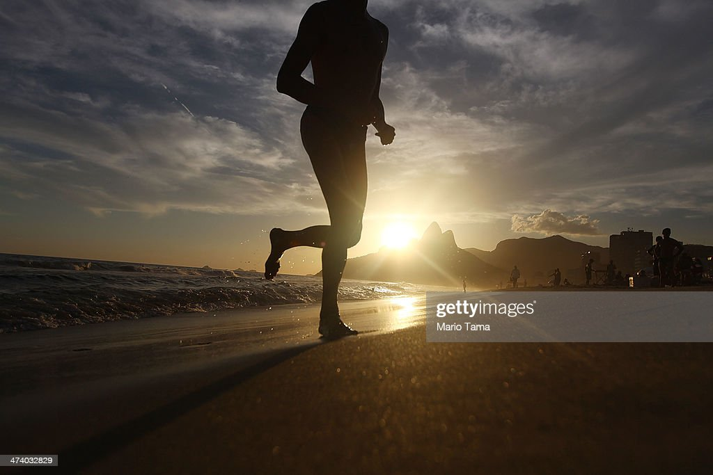 A man jogs on Ipanema Beach on February 21, 2014 in Rio de Janeiro, Brazil. Brazil is ramping up to host the 2014 FIFA World Cup and the Rio 2016 Olympic Games.