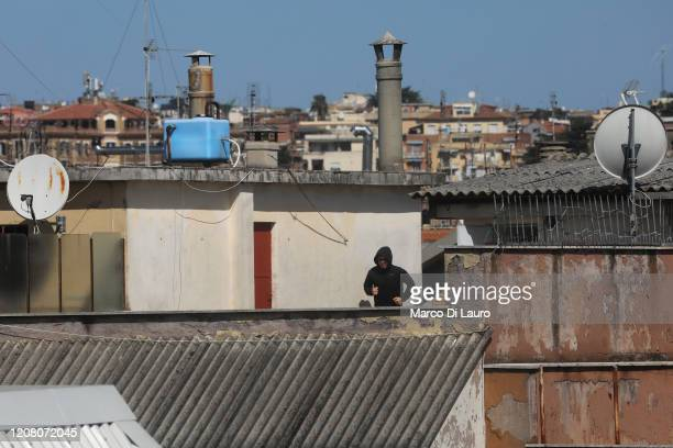A man jogs on the roof of his building during lockdown on March 23 2020 in Rome Italy As Italy extends its nationwide lockdown to control the spread...