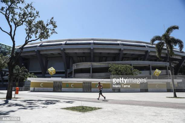 A man jogs past Maracana stadium the site of the opening and closing ceremonies of the Rio 2016 Olympic Games on September 5 2017 in Rio de Janeiro...