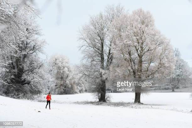 Man jogs through the park as some areas of the United Kingdom see the first snow of the year, on January 23, 2019 in High Wycombe, United Kingdom.