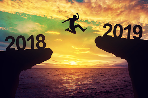 A man jump between 2018 and 2019 years. 912400306