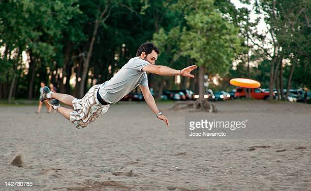 Man jumping after frisbee