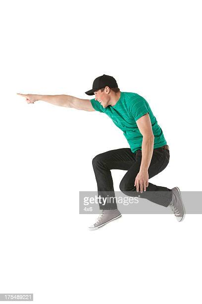 Man jumping and pointing away