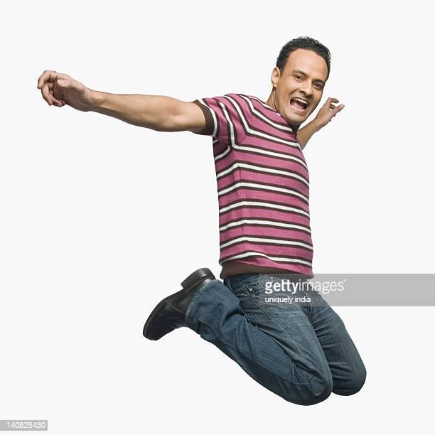 man jumping and shouting - ボーダーシャツ ストックフォトと画像