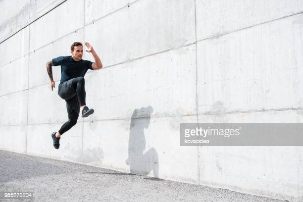 Man jumping and sprinting outdoors