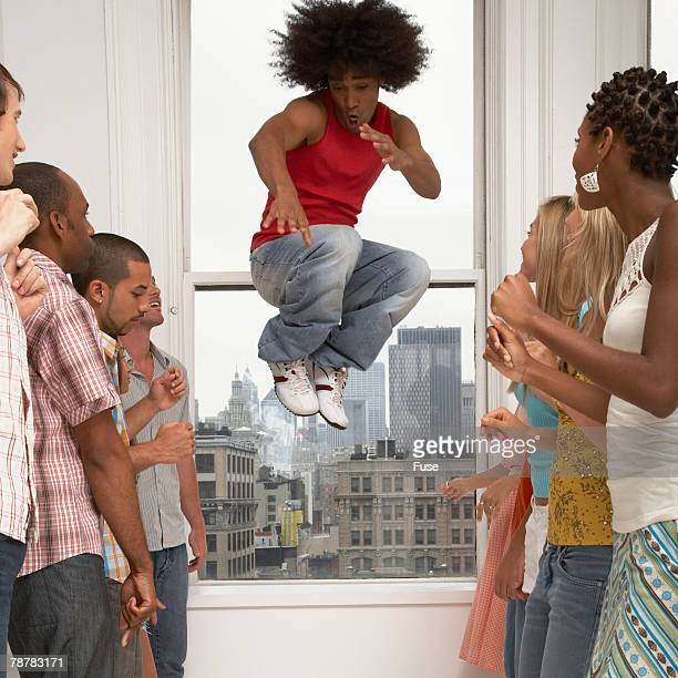Man Jumping at a Party