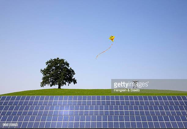 man jumping at solar power panels