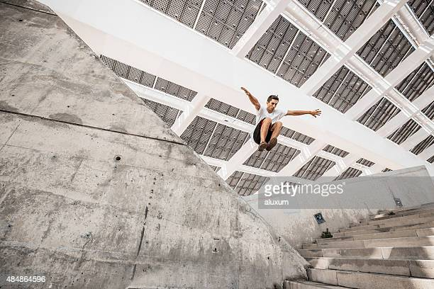 Man jumping doing urban parkour