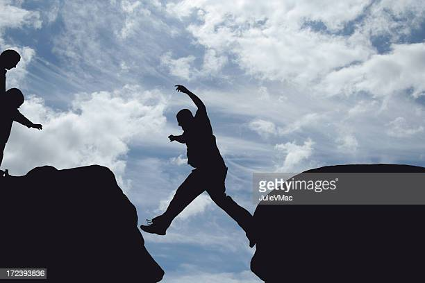 Man jumping forward from cliff