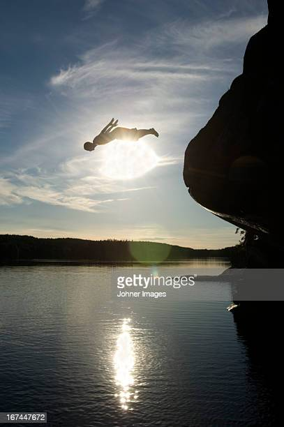 A man jumping from a cliff, Sweden.
