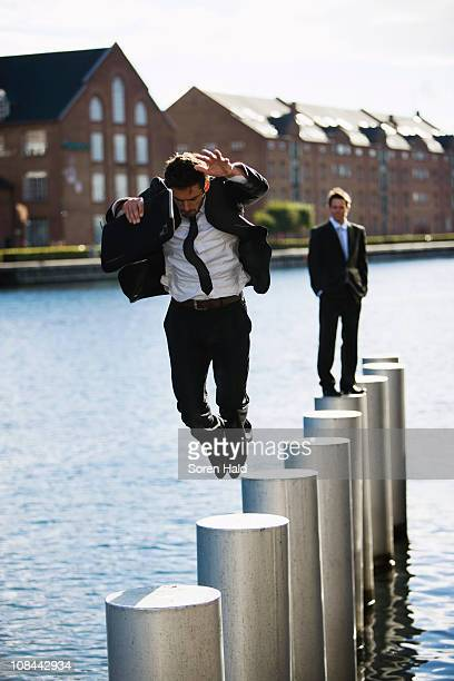 Man jumping from pole to pole