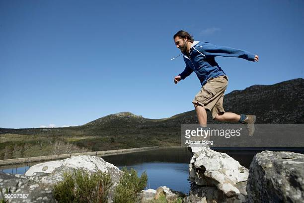 Man jumping from rock