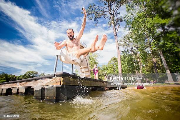 Man jumping from slide at Jackson Lake, Georgia, USA