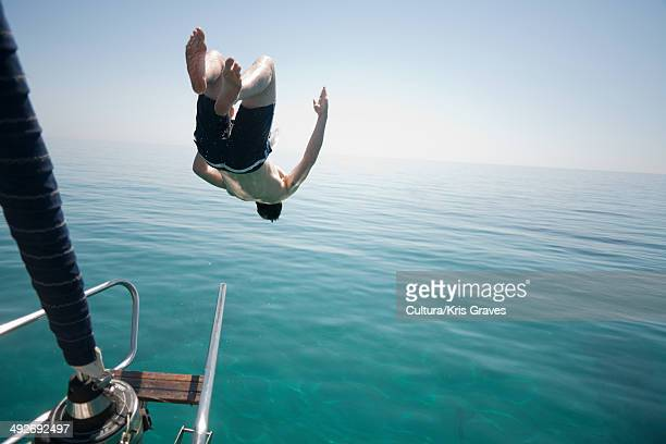 Man jumping head first into the sea