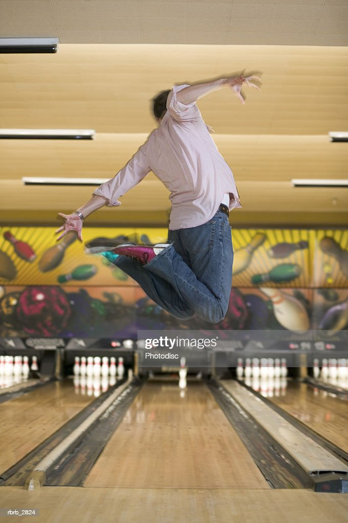 Man jumping in a bowling alley : Foto de stock