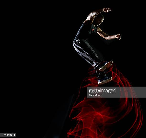 man jumping in air with light trails - clair obscur photos et images de collection