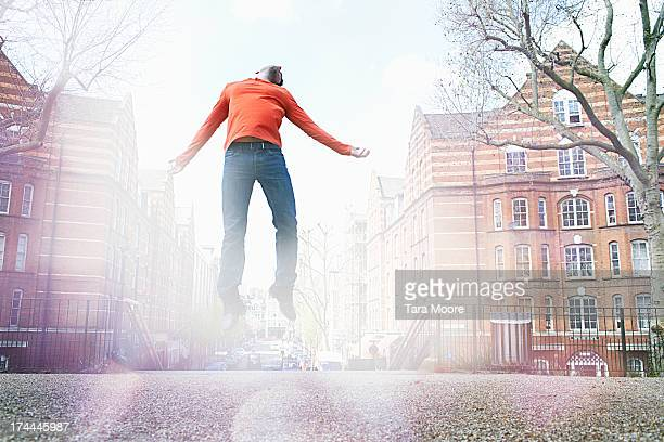 man jumping in city