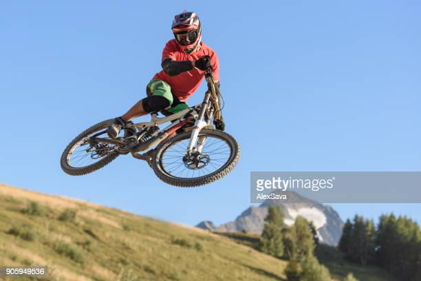 Man jumping in midair with mountain bike