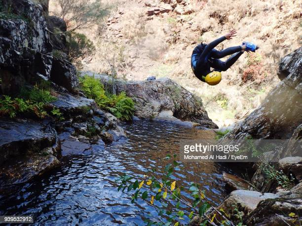 Man Jumping In River