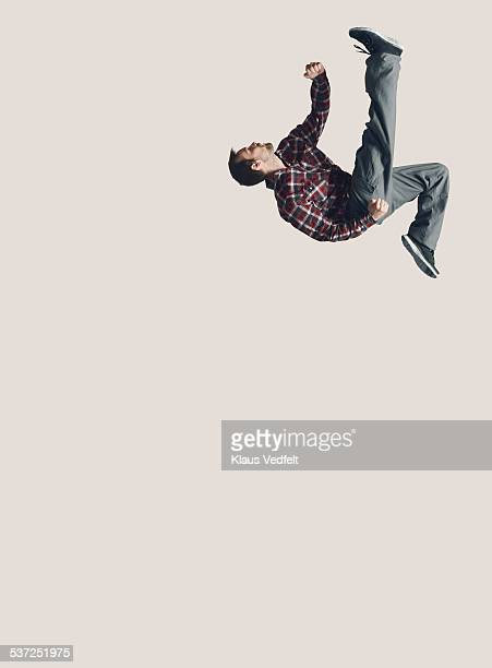 Man jumping in the air with one leg stretched