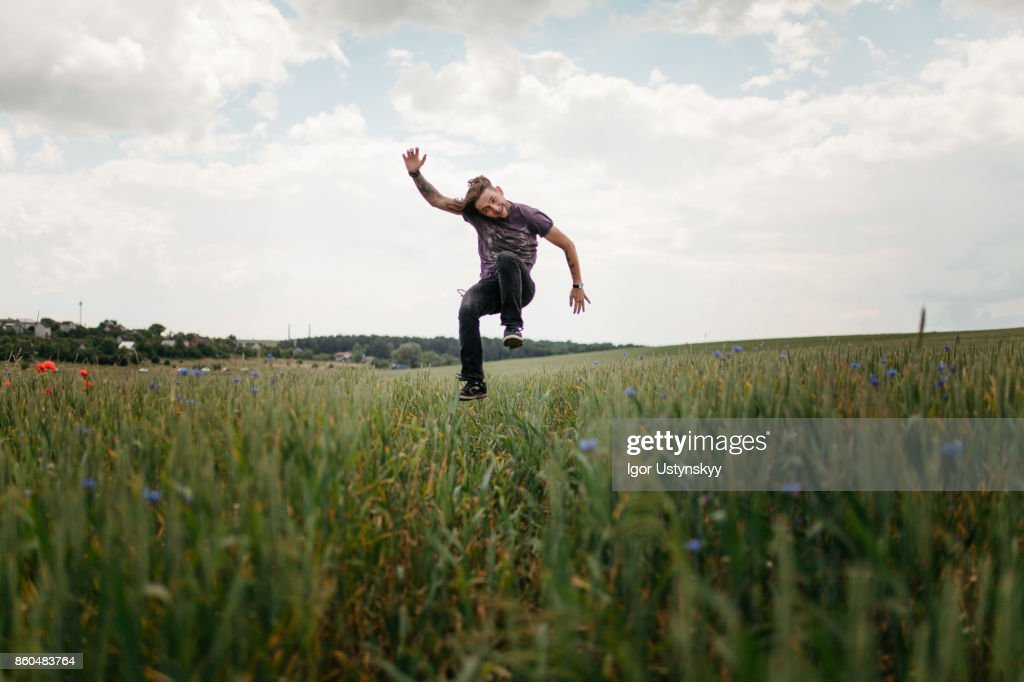 Man jumping in the field : Stock Photo