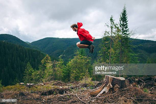 Man jumping in the mountains