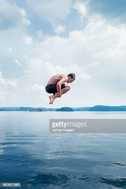 Man jumping into sea