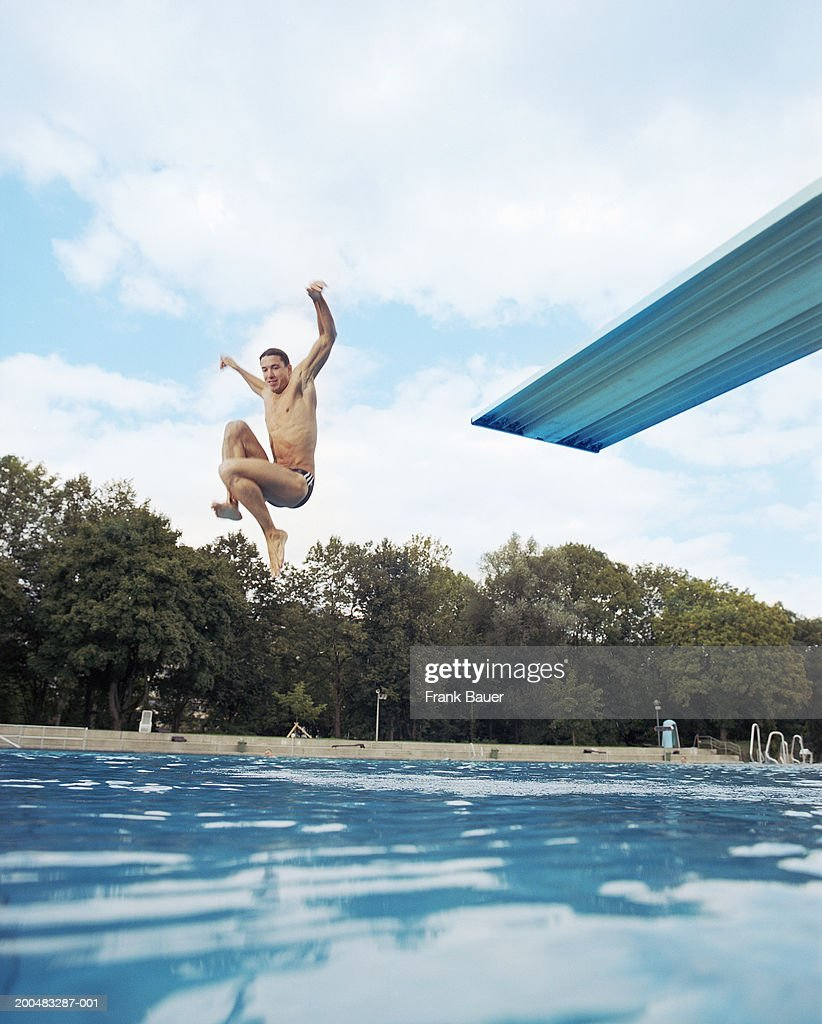 Pool Bauer jumping into swimming pool stock photo getty images