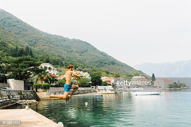 Man jumping into water,  Kotor bay