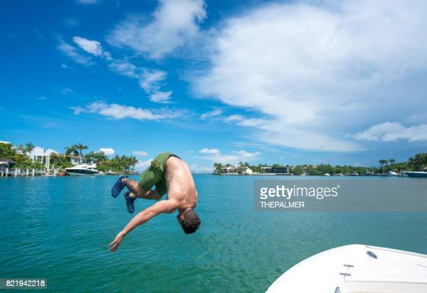 Man jumping off boat