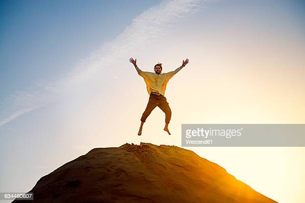 Man jumping on hill
