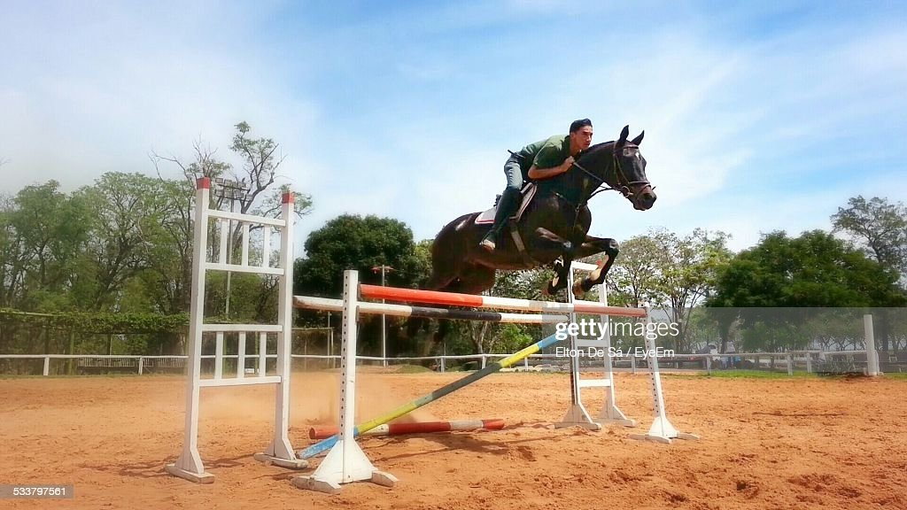 Man Jumping On Horse : Foto stock